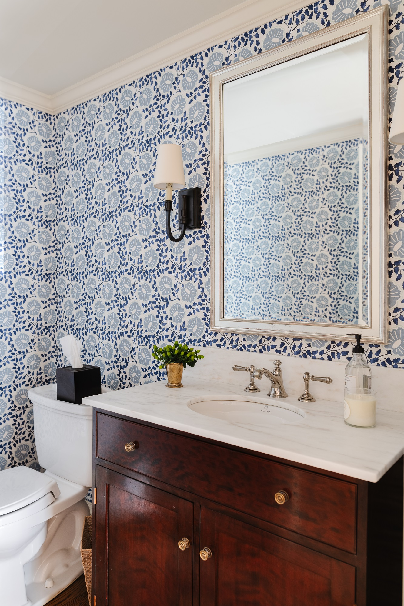 Powder room with blue patterned wallpaper