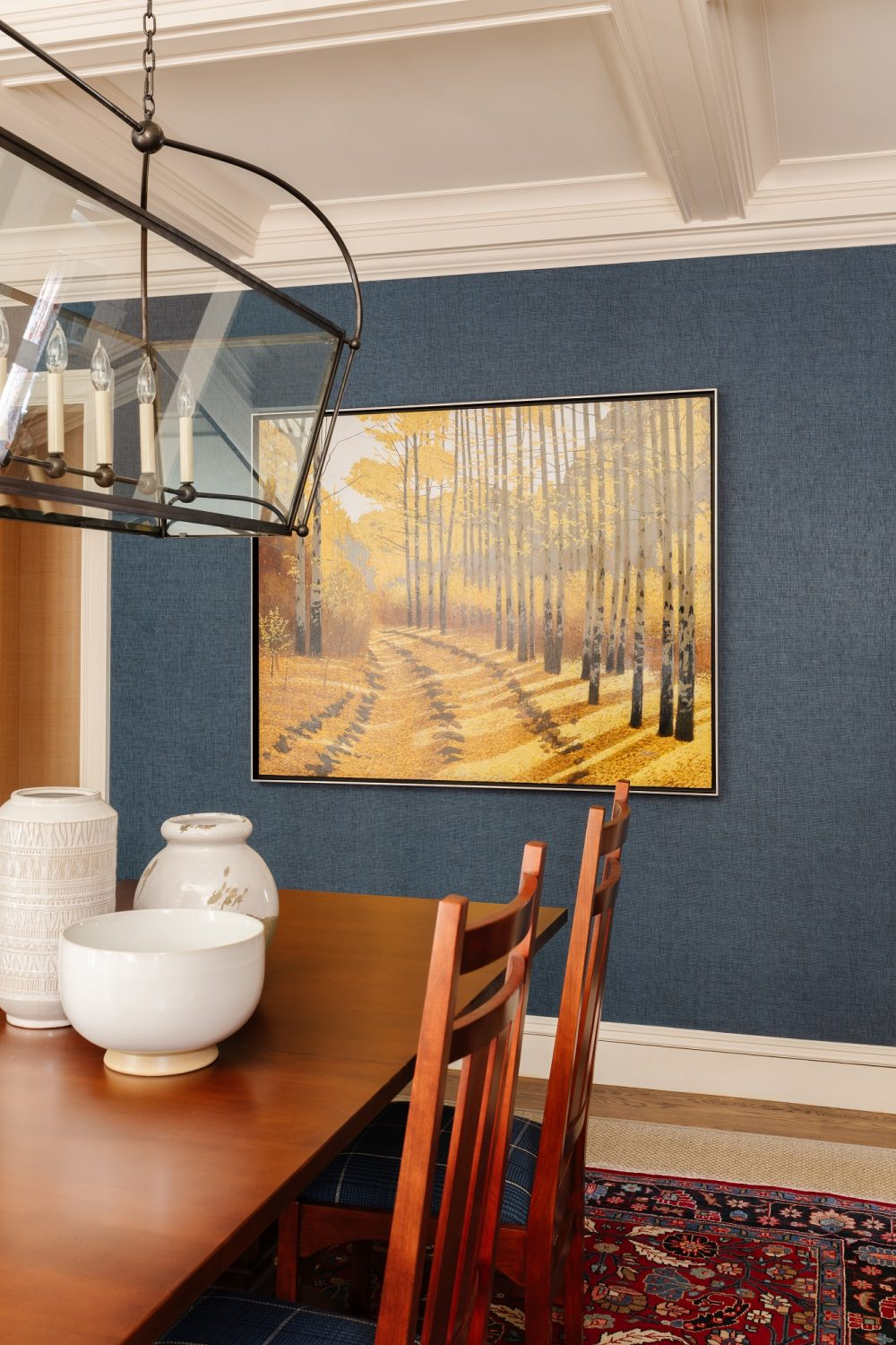 Dining room table with pottery and painting