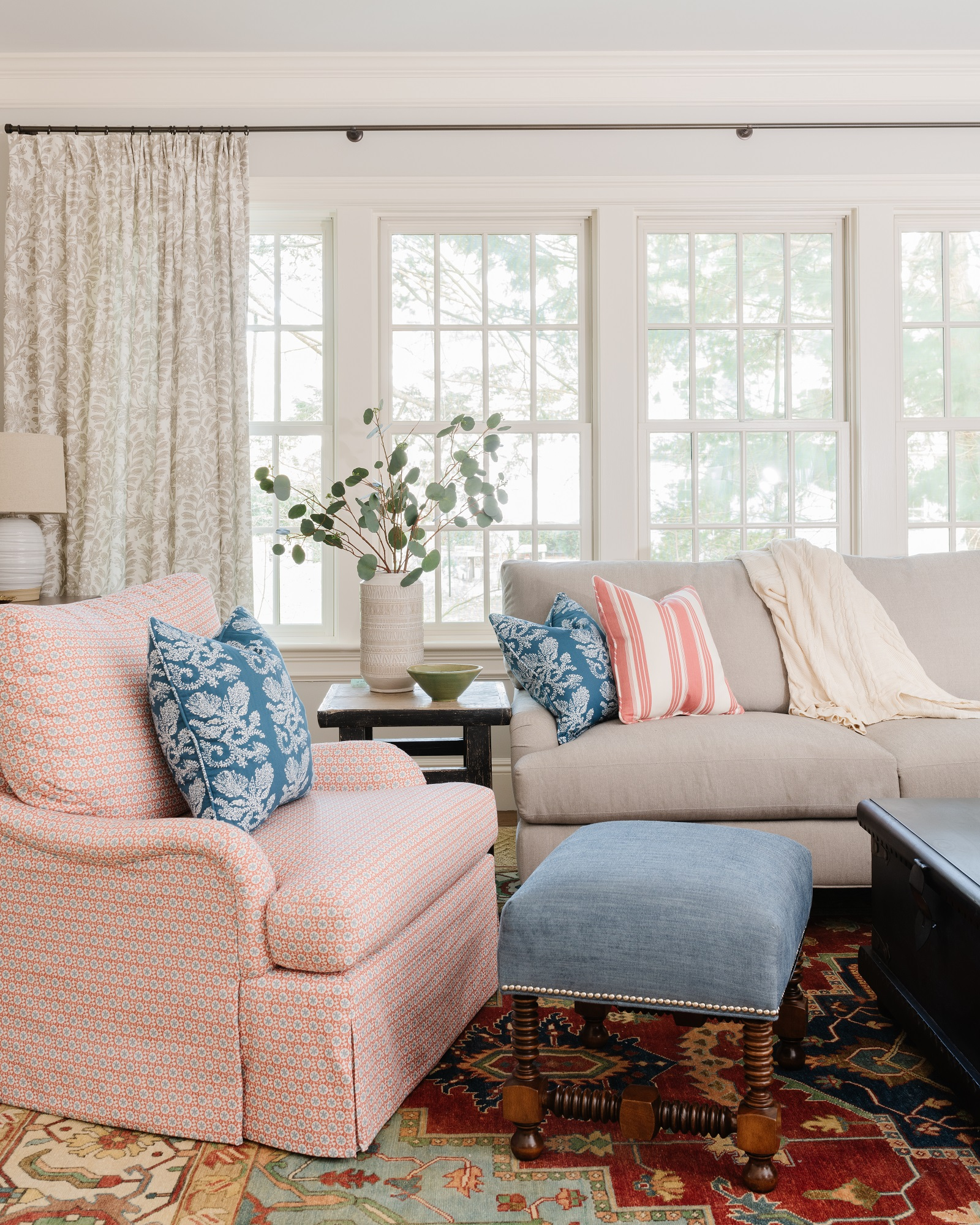 Family room design with cozy sectional, armchair and ottoman
