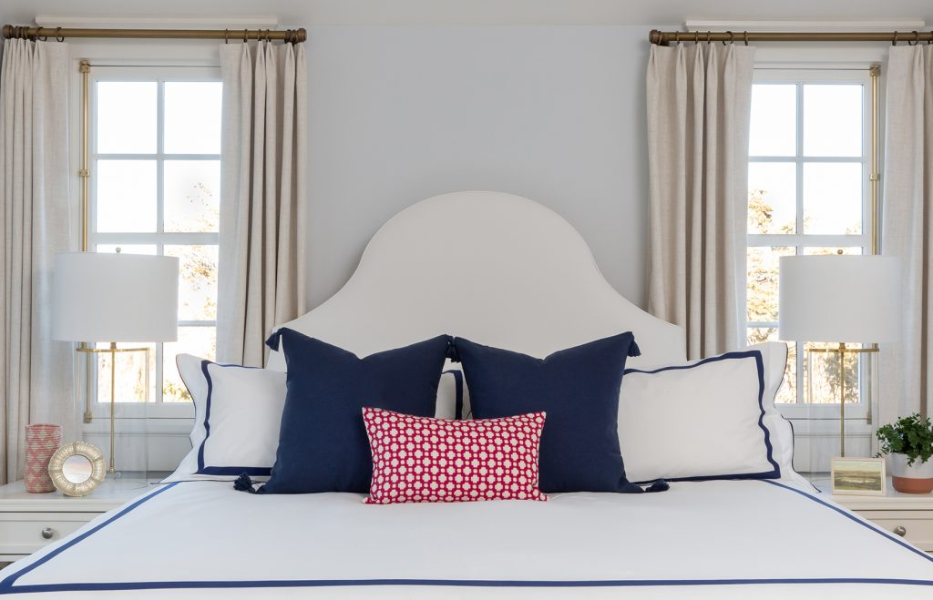 Master bedroom design with crisp white bedding and custom drapery