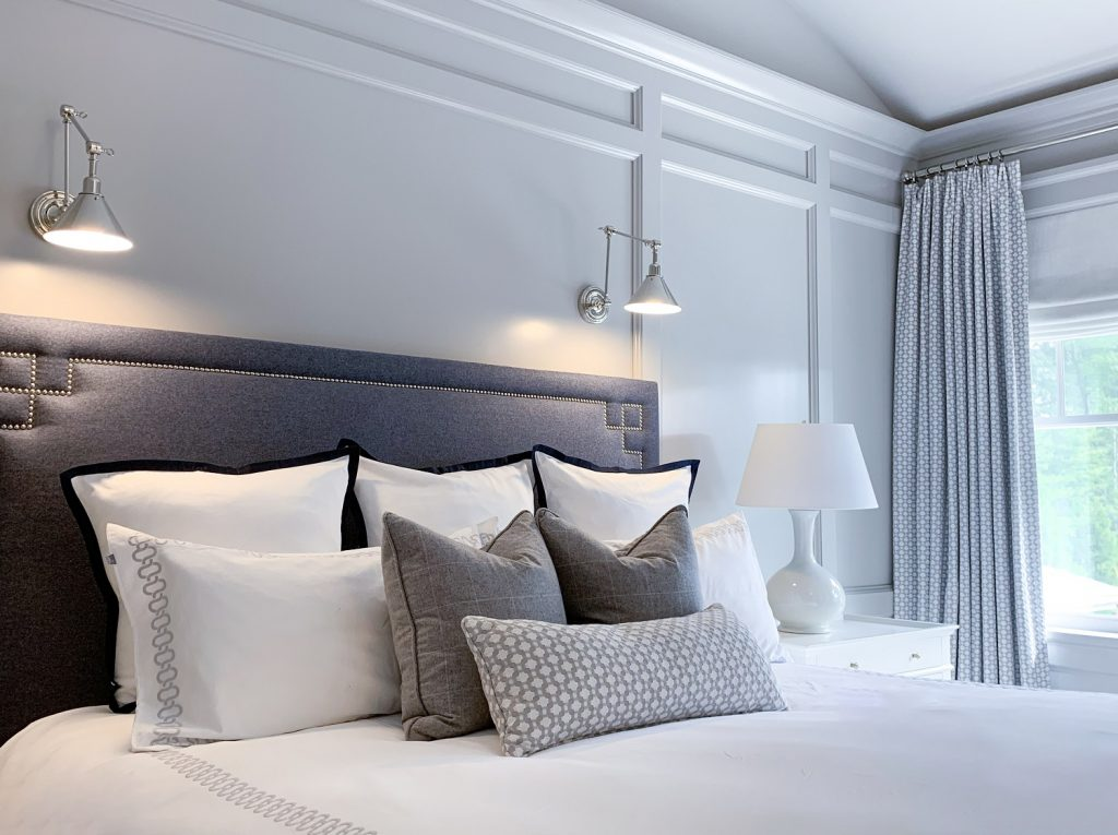 Master bedroom lighting with sconces and table lamps