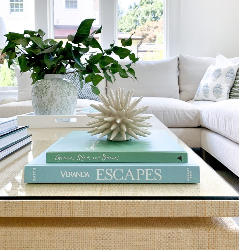 Spring table decor with stacked books, greenery and decorative objects