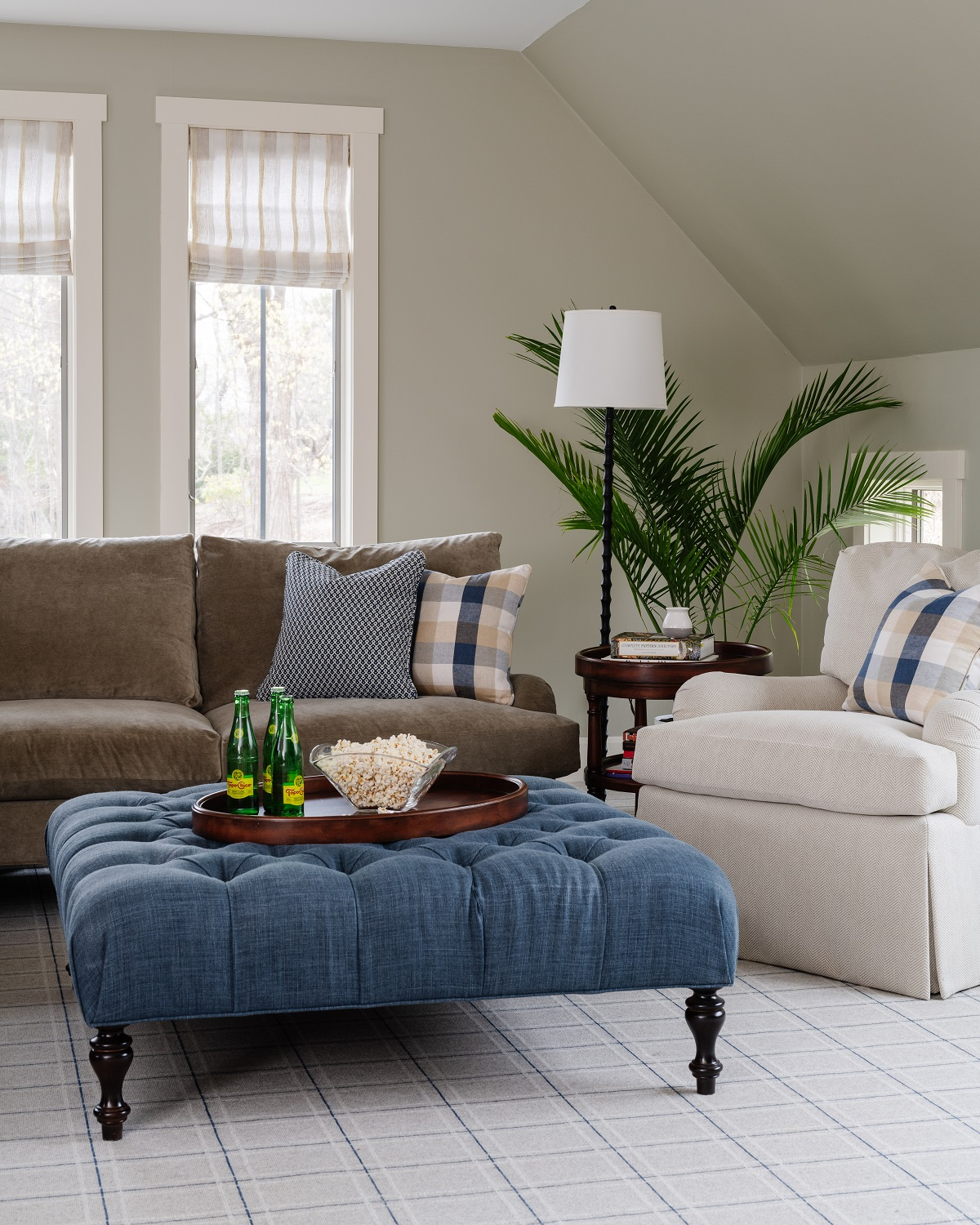 Blue and neutral family room with plaid pillow accents