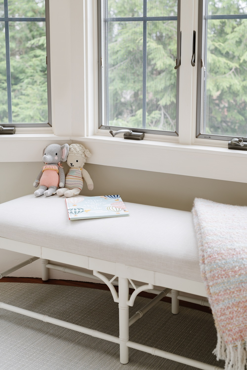 Detail of children's bedroom with bed bench and throw blanket