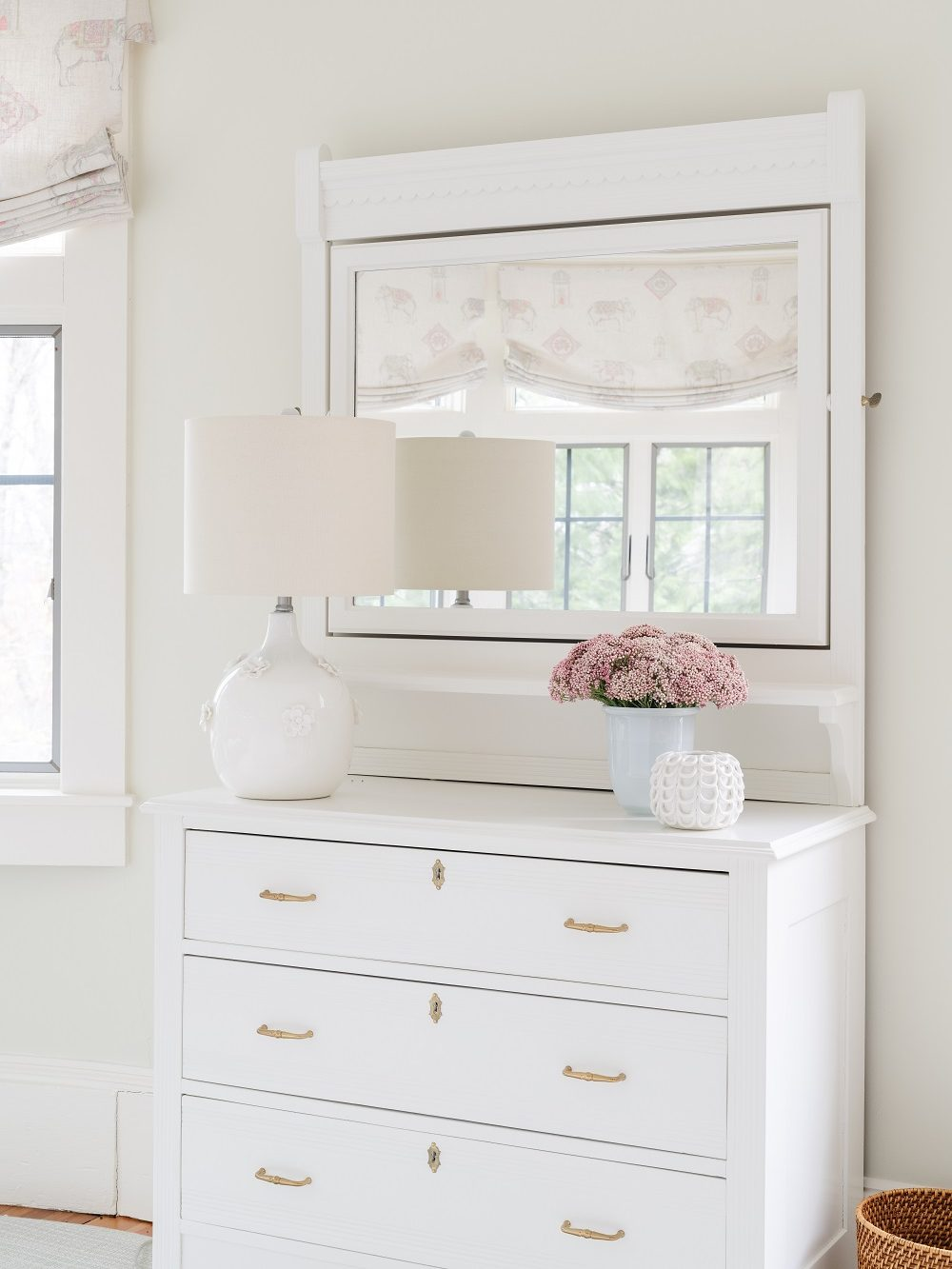 White dresser with scalloped details and gold pulls