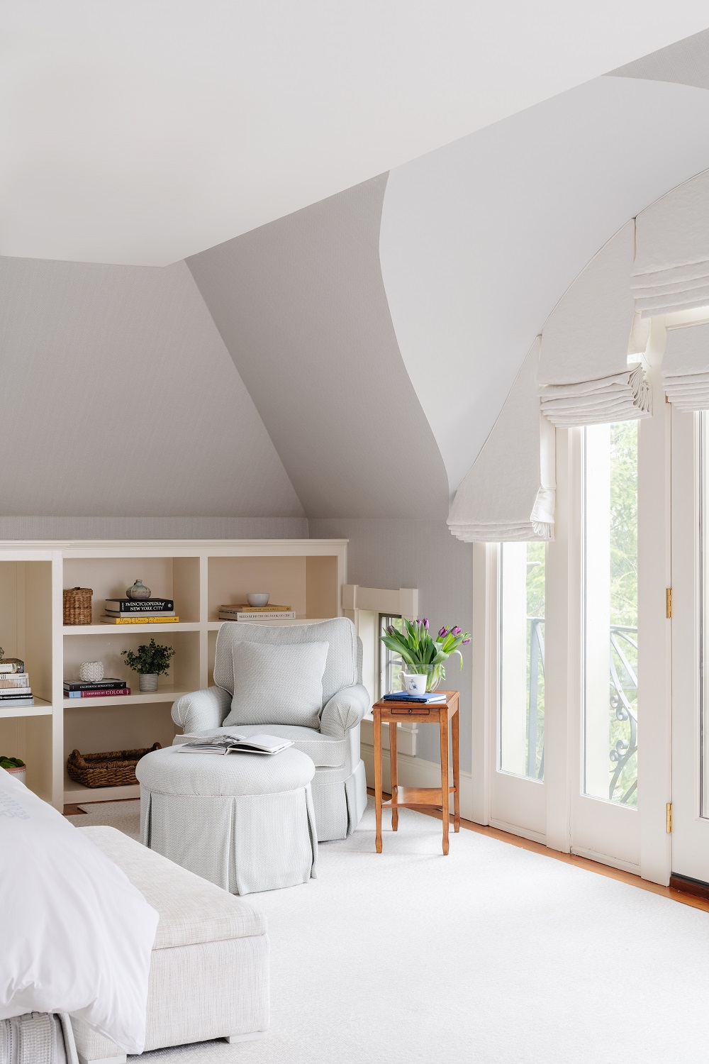 Master bedroom reading nook with custom built-in shelving