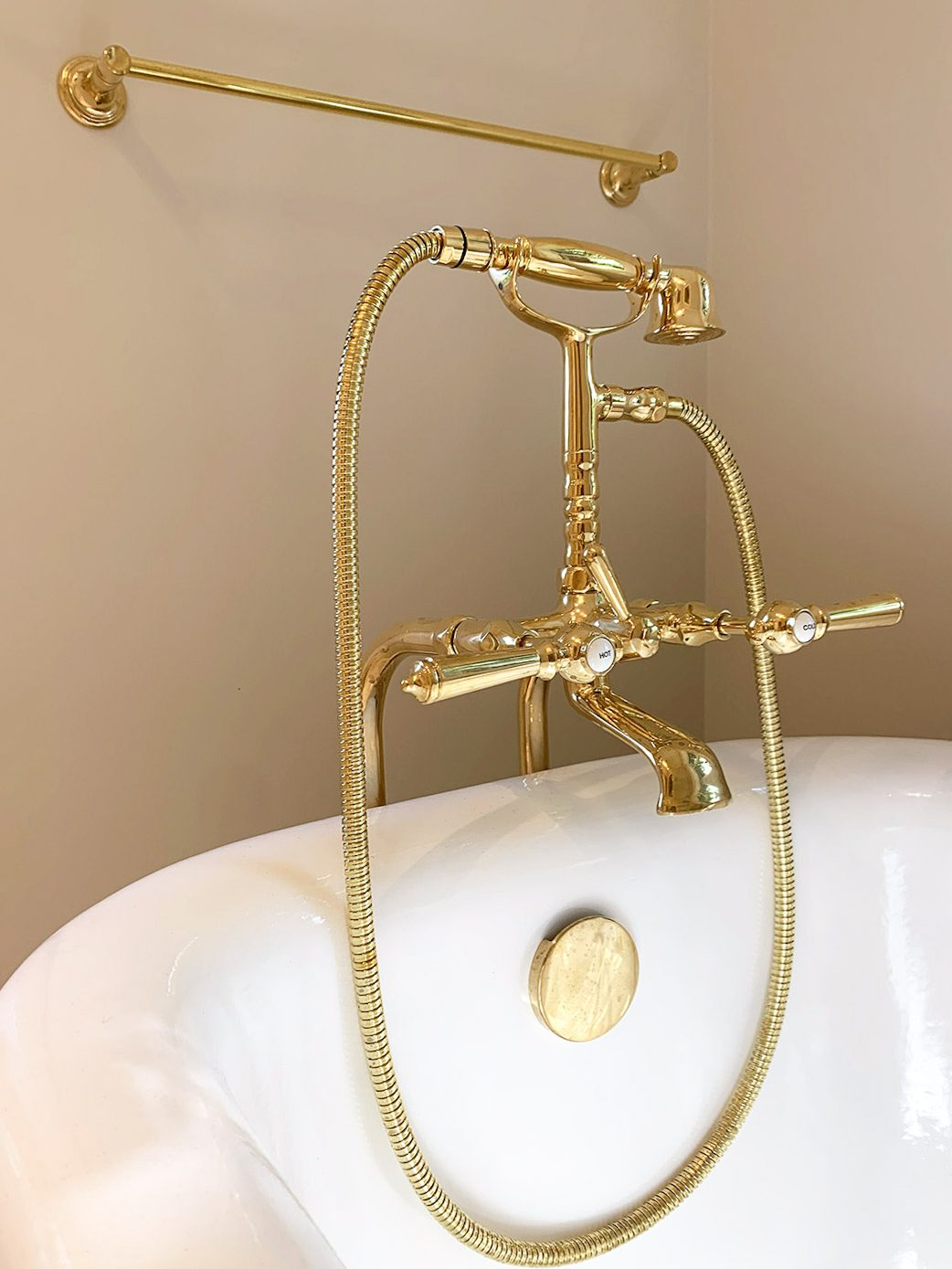 Unlacquered brass fixtures in a soaking tub