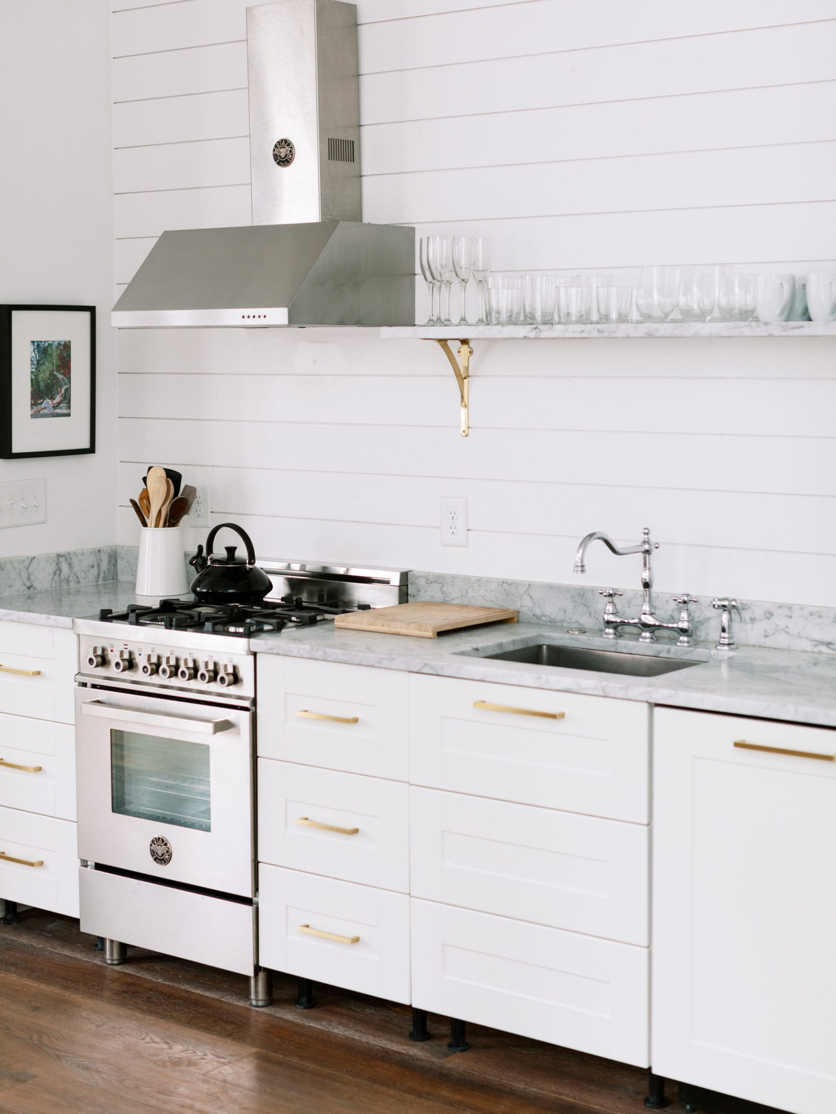 Mixed metals in clean white kitchen